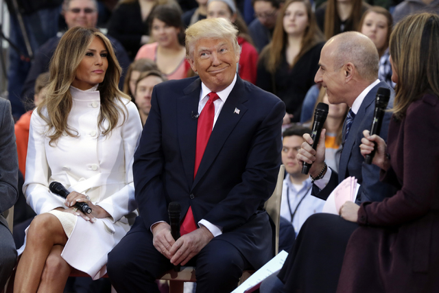 """Republican presidential candidate Donald Trump, and his wife, Melania, are interviewed by co-host Matt Lauer, third left, and Savannah Guthrie, right, on the NBC """"Today"""" television program, in New ..."""