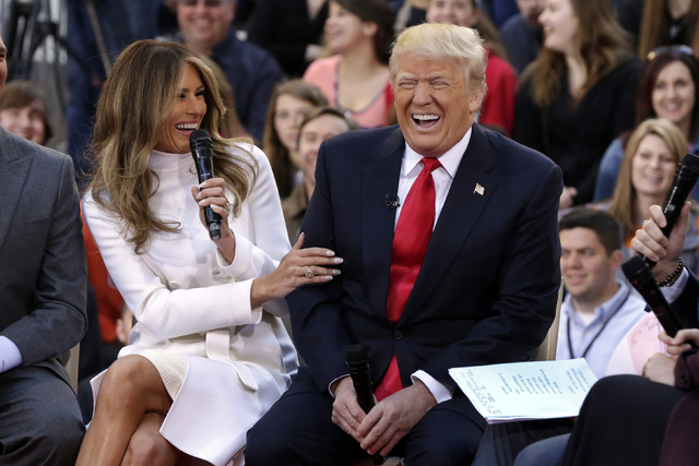 """Republican presidential candidate Donald Trump reacts as his wife, Melania, answers a question during an interview on the NBC """"Today"""" television program, in New York, Thursday, April 21, 2016. (AP ..."""