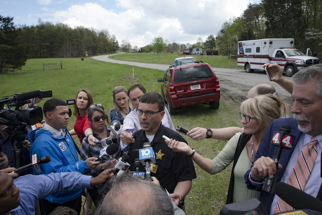 Lt. Michael Preston of the Ross County Sheriff's Department speaks to the media on Union Hill Road, Friday, April 22, 2016, in Pike County, Ohio. Shootings with multiple fatalities were reported a ...