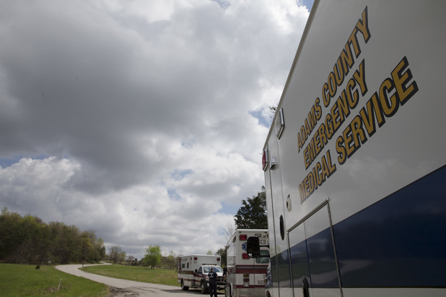 Emergency vehicles park outside the perimeter of a crime scene, Friday, April 22, 2016, in Pike County, Ohio.  (John Minchillo/Associated Press)