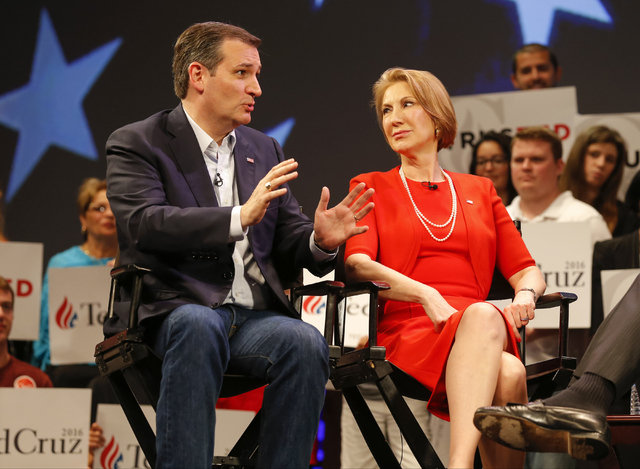 Republican presidential candidate Sen. Ted Cruz, R-Texas, speaks to Carly Fiorina in Orlando, Fla., Friday, March 11, 2016. Cruz has picked Fiorina as his running mate. (Mike Carlson/AP)