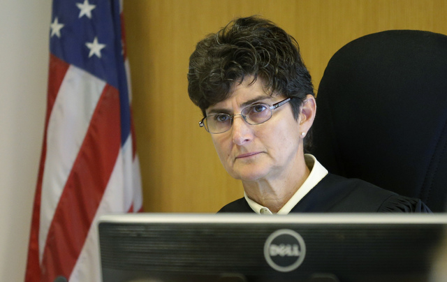 King County Superior Court Judge Julie Spector listens to motions prior to the arraignment of John Charlton, the man accused of dismembering a woman in her suburban home and dumping her body parts ...