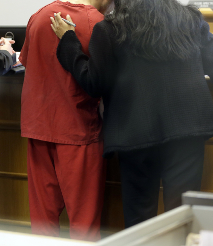 John Charlton, left, the man accused of dismembering a woman in her suburban home and dumping her body parts in Seattle recycling bins, is viewed through a window as he stands with one of his atto ...