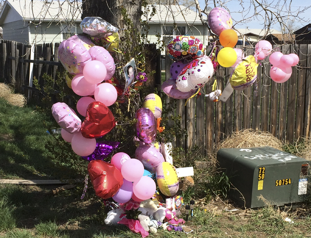 A memorial is placed in front of the house for 1-year-old Kenzley Olson on Friday, April 22, 2016, in Poplar, Mont. A federal investigator says a woman beat to death the girl on a Montana Indian r ...