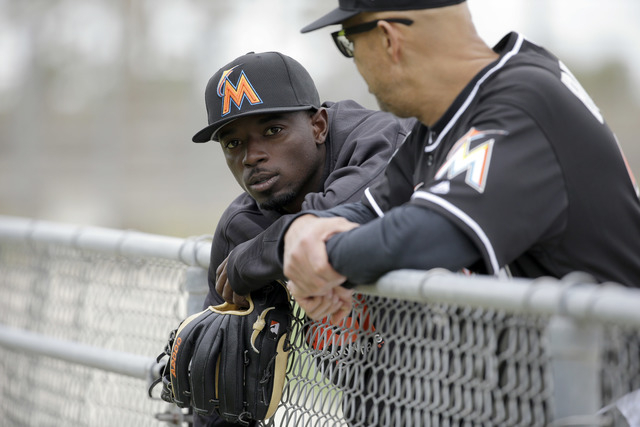 In this Feb. 19, 2016 file photo, Miami Marlins second baseman Dee Gordon leans against a fence during spring training baseball practice in Jupiter, Fla. (Jeff Roberson, File/AP)