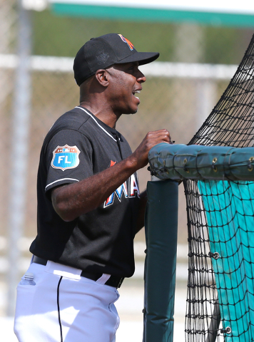 In this March 4, 2016 file photo, Miami Marlins hitting coach Barry Bonds gives instructions to second baseman Dee Gordon, not shown, during batting practice before a spring training baseball game ...