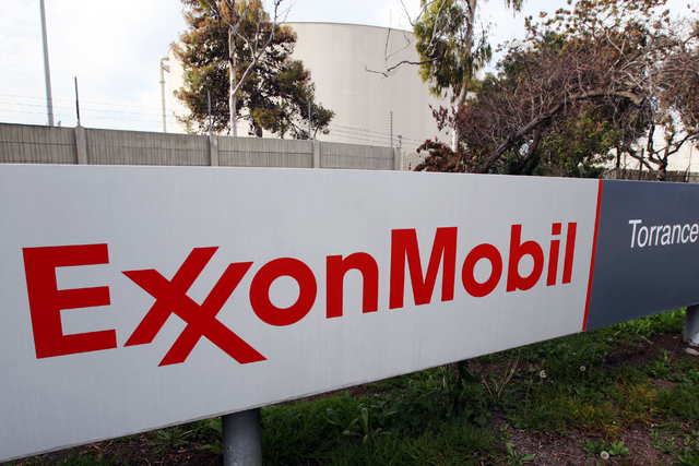This Jan. 30, 2012, file photo, shows the sign for the Exxon Mobil Torrance Refinery in Torrance, Calif. Exxon Mobil Corp. reports financial results Friday, April 29, 2016. (Reed Saxon/Associated  ...
