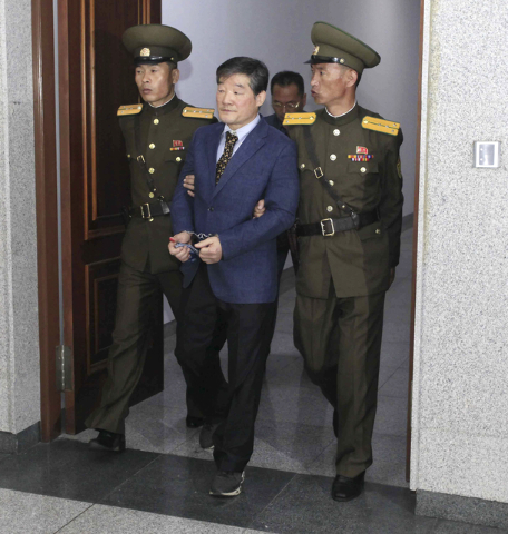 Kim Dong Chul, center, a U.S. citizen detained in North Korea, escorted from the courtroom after his trial Friday, April 29, 2016, in Pyongyang, North Korea. A North Korean court has sentenced Chu ...