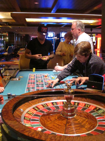 This March 9, 2016 photo shows gamblers placing bets in a roulette game at the Tropicana casino in Atlantic City, N.J.  (Wayne Parry/Associated Press)