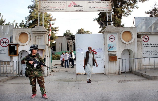 An Afghan National Army soldier stands guard at the gate of a Doctors Without Borders hospital in Kunduz, Afghanistan, Oct. 15, 2015.  (Najim Rahim/AP)