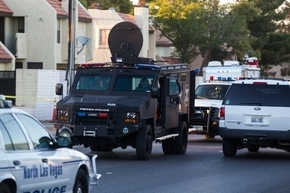 A Las Vegas SWAT truck exits the scene where murder suspect Eric Orduna was taken into custody on an arrest warrant by the Criminal Apprehension Team after negotiations at an apartment on the 2100 ...