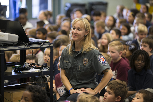 Melanie Bangle, paramedic for Community Ambulance, gives a presentation on how and when to call 911 in an emergency at  Glen Taylor Elementary School on Friday, April 29, 2016, in Henderson, Nev.  ...