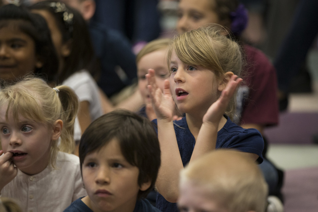 Madilyn Kingman, 7, center, claps during a 911 Education Month event at Glen Taylor Elementary School on Friday, April 29, 2016, in Henderson, Nev. Erik Verduzco/Las Vegas Review-Journal Follow @E ...