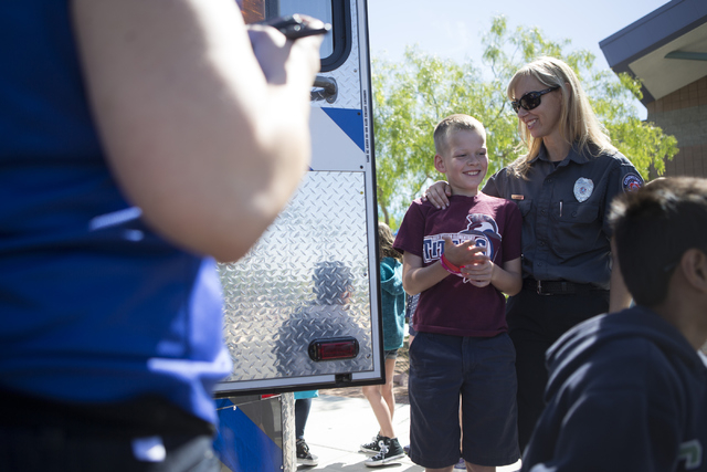 Melanie Bangle, right, paramedic for Community Ambulance, and her son Jacob Dennon, stands together after Bangle gave a presentation on how and when to call 911 in an emergency at Glen Taylor Elem ...