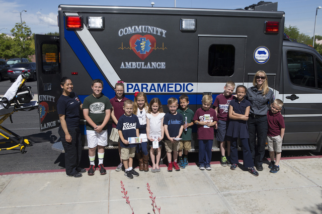 Students pose with a paramedic team during a 911 Education Month event at Glen Taylor Elementary School on Friday, April 29, 2016, in Henderson, Nev. Erik Verduzco/Las Vegas Review-Journal Follow  ...