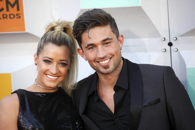 Michael Ray walks the red carpet with a guest at the 51st Academy of Country Music Awards Sunday, April 3, 2016, at the MGM Grand in Las Vegas. (Rachel Aston/Las Vegas Review-Journal)  Follow @roo ...