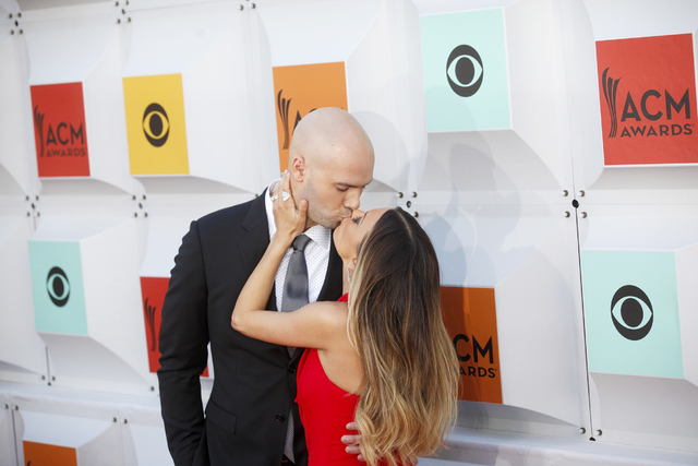 Mike Caussin and wife Jana Kramer kiss on the red carpet at the 51st Academy of Country Music Awards Sunday, April 3, 2016, at the MGM Grand in Las Vegas.  (Rachel Aston/Las Vegas Review-Journal)  ...