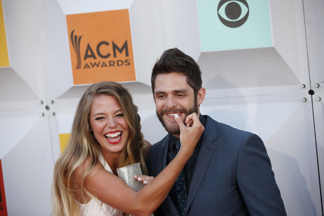 Thomas Rhett and wife Lauren Gregory walk the red carpet at the 51st Academy of Country Music Awards Sunday, April 3, 2016, at the MGM Grand in Las Vegas.  (Rachel Aston/Las Vegas Review-Journal)F ...