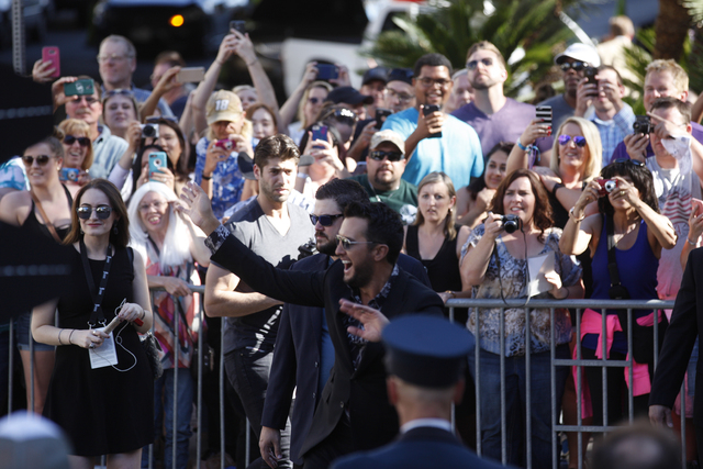 Luke Bryan acknowledges fans before walking the red carpet at the 51st Academy of Country Music Awards Sunday, April 3, 2016, at the MGM Grand in Las Vegas.  (Rachel Aston/Las Vegas Review-Journal ...
