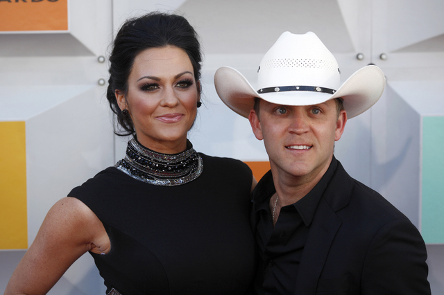 Justin Moore and wife Katie walk the red carpet at the 51st Academy of Country Music Awards Sunday, April 3, 2016, at the MGM Grand in Las Vegas.  (Rachel Aston/Las Vegas Review-Journal) Follow @r ...