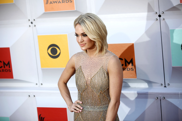 Carrie Underwood walks the red carpet at the 51st Academy of Country Music Awards Sunday, April 3, 2016, at the MGM Grand in Las Vegas. (Rachel Aston/Las Vegas Review-Journal)Follow @rookie__rae
