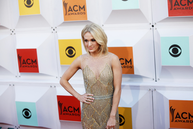 Carrie Underwood walks the red carpet at the 51st Academy of Country Music Awards Sunday, April 3, 2016, at the MGM Grand in Las Vegas.  (Rachel Aston/Las Vegas Review-Journal) Follow @rookie__rae