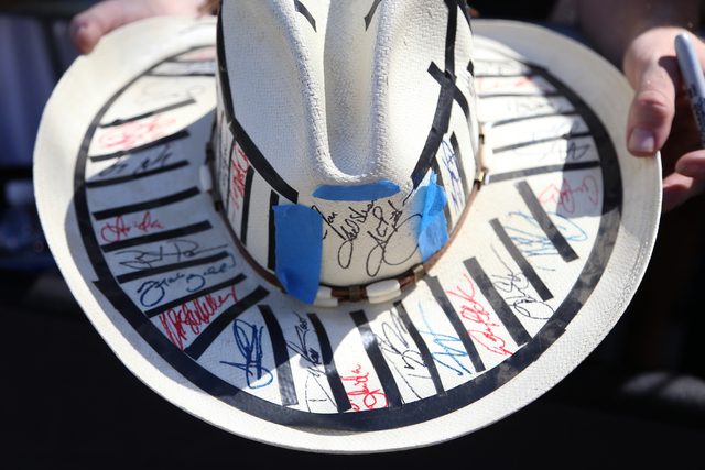 Jonathan Reynolds holds his hat with almost 60 signatures of new country artists outside the 51st Academy of Country Music Awards Sunday, April 3, 2016, at the MGM Grand in Las Vegas. (Rachel Asto ...
