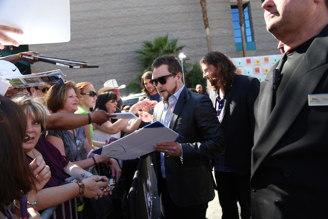 Mike Eli of the Eli Young Band sings autographs for fans outside the 51st Academy of Country Music Awards Sunday, April 3, 2016, at the MGM Grand in Las Vegas.  (Rachel Aston/Las Vegas Review-Jour ...