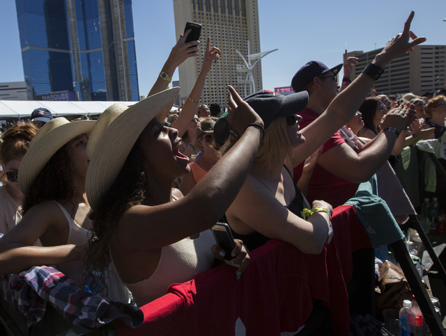 "Brett Eldredge fans cheer as he performs during the last day of the American Country Music's ""Party for a Cause,"" event at the Las Vegas Festival Grounds on Sunday, April 3, 2016 ..."
