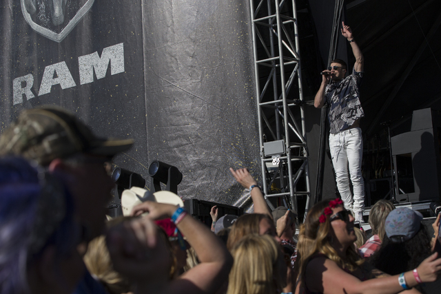"Sam Hunt performs during the last day of the American Country Music's ""Party for a Cause,"" event at the Las Vegas Festival Grounds on Sunday, April 3, 2016 in Las Vegas. Benjamin Hager/Las Vegas R ..."