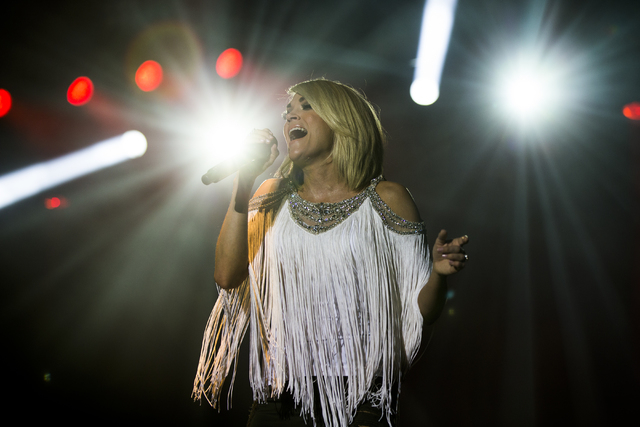 "Carrie Underwood performs during the first day of the American Country Music's ""Party for a Cause,"" event at the Las Vegas Festival Grounds on Friday, April 1, 2016 in Las Vegas. ..."