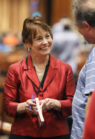 United States Senate candidate Sharron Angle meets with a supporter during a book signing and campaigning stop at the Clark County Republican Party county convention at the Rio hotel-casino Saturd ...