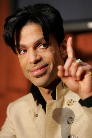 Recording artist Prince speaks during a news conference about his exclusive recording agreement between himself and Universal Records on Tuesday, Dec. 13, 2005, in Beverly Hills, Calif.  (AP Photo ...