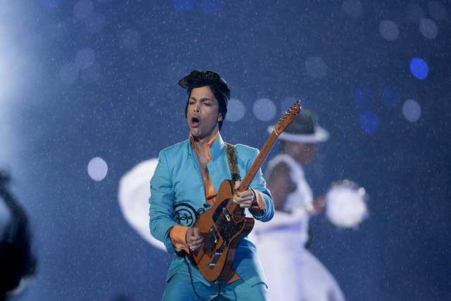 Prince performs during the halftime show at the Super Bowl XLI football game at Dolphin Stadium in Miami on Sunday, Feb. 4, 2007. ((Alex Brandon/AP)