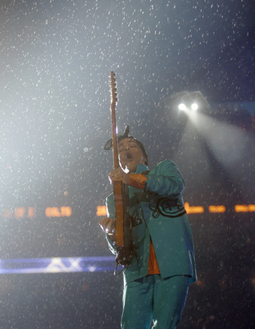 Prince performs during halftime of the Super Bowl XLI football game at Dolphin Stadium in Miami on Sunday, Feb. 4, 2007. (David J. Phillip/AP)
