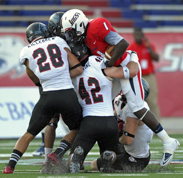 Southern Utah defensive back Miles Killebrew (28) and linebacker Zak Browning (42) stop South Alabama wide receiver Shavarez Smith (1) in the first quarter of an NCAA college football game Thursda ...