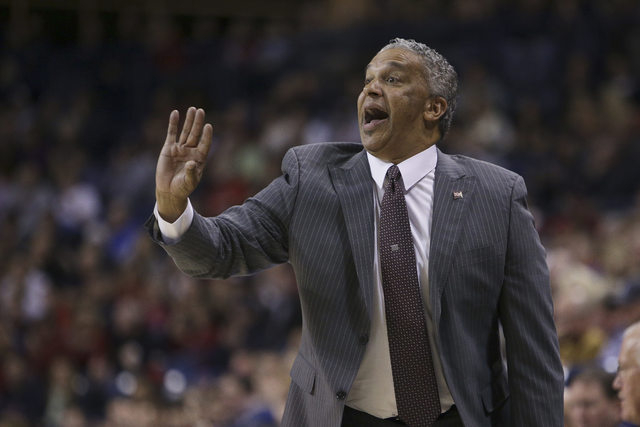 New Mexico States Head Coach Marvin Menzies watches his team play against Gonzaga during the first half of an NCAA basketball game, in Spokane, Wash., on Saturday, Dec. 7, 2013. (AP Photo/Young Kwak)