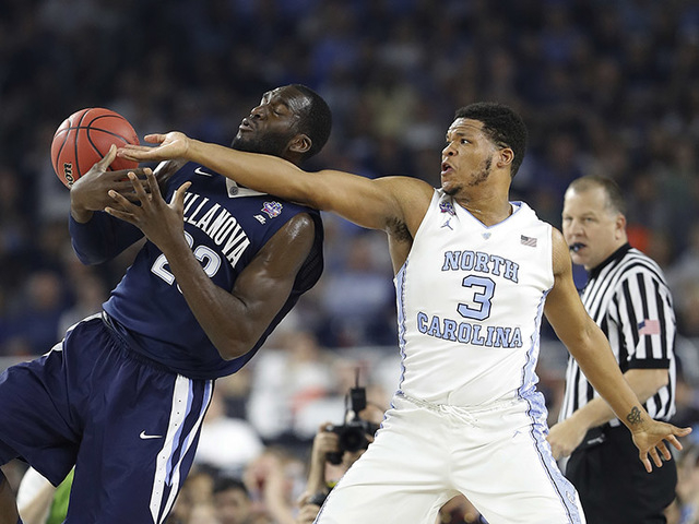 Villanova's Daniel Ochefu (23) and North Carolina's Kennedy Meeks (3) battle for a rebound during the first half of the NCAA Final Four tournament college basketball championship game Monday, Apri ...