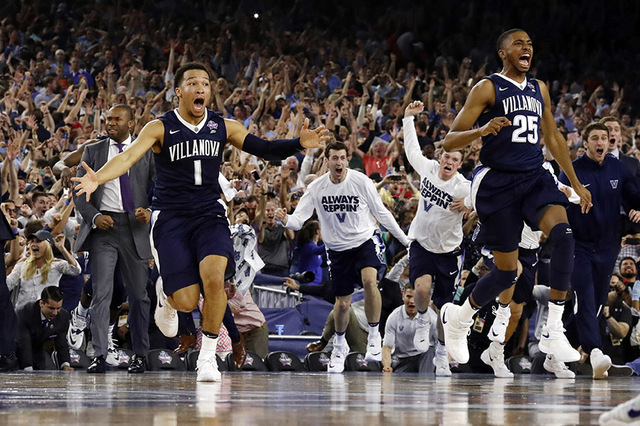 Villanova's Jalen Brunson (1), Mikal Bridges (25) and their teammates celebrate after the NCAA Final Four tournament college basketball championship game against North Carolina, Monday, April 4, 2 ...