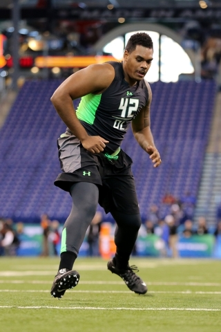 Notre Dame offensive lineman Ronnie Stanley during a drill at the NFL football scouting combine Friday, Feb. 26, 2016, in Indianapolis. (AP Photo/Gregory Payan)