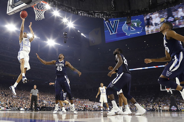 North Carolina's Brice Johnson (11) goes up for a basket during the first half of the NCAA Final Four tournament college basketball championship game against North Carolina, Monday, April 4, 2016, ...