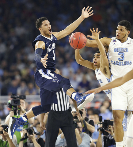 Villanova guard Josh Hart (3) North Carolina guard Marcus Paige (5) and North Carolina forward Kennedy Meeks (3) chase a loose ball  during the first half of the NCAA Final Four tournament college ...