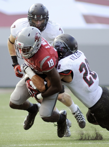 Southern Utah's Miles Killebrew (28) and Matt Holley (7) wrap up Washington State's Kristoff Williams (18) during the second half of an NCAA college football game on Saturday, Sept. 14, 2013, in P ...