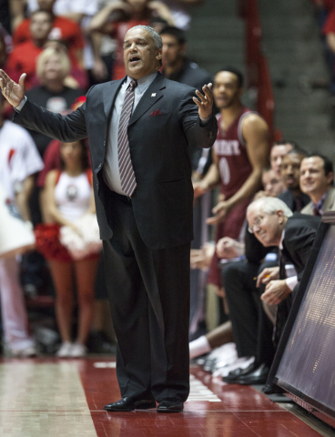 New Mexico State coach Marvin Menzies watches his team play New Mexico in the first half of an NCAA college basketball game Tuesday, Dec. 17, 2013, in Albuquerque, N.M.(AP Photo/Craig Fritz)