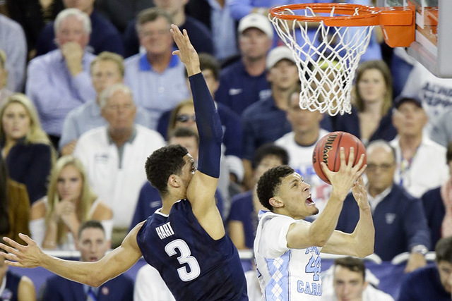 North Carolina forward Justin Jackson (44) shoots against Villanova guard Josh Hart (3) during the first half of the NCAA Final Four tournament college basketball championship game Monday, April 4 ...