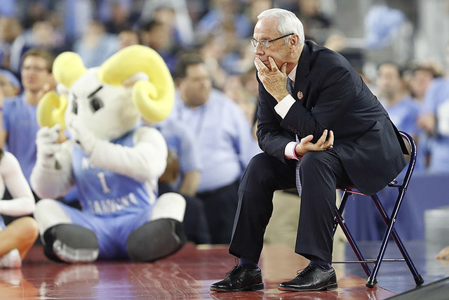 North Carolina head coach Roy Williams watches play against Villanova during the first half of the NCAA Final Four tournament college basketball championship game Monday, April 4, 2016, in Houston ...
