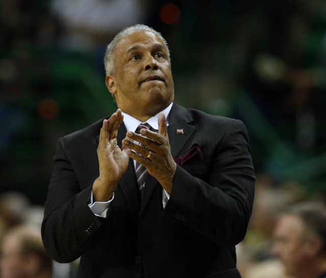 New Mexico State  head coach Marvin Menzies looks at the scoreboard during an NCAA college basketball game against Baylor in the second half Wednesday, Dec. 23, 2015, in Waco, Texas. (AP/Rod Aydel ...