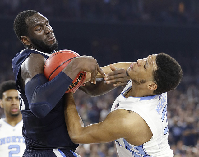 Villanova forward Daniel Ochefu (23) and North Carolina forward Kennedy Meeks (3) scramble for the ball during the second half of the NCAA Final Four tournament college basketball championship gam ...