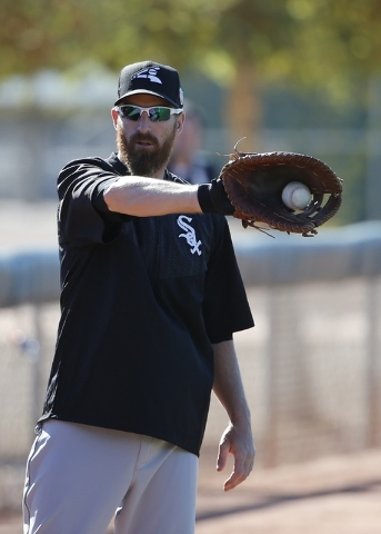 Chicago White Sox's Adam LaRoche catches the baseball as he warms up during a spring training baseball workout Wednesday, Feb. 24, 2016, in Glendale, Ariz. (Ross D. Franklin/AP)
