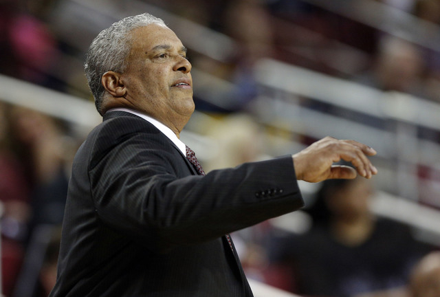 New Mexico State head coach Marvin Menzies gives instructions to his players from the sidelines during the first half of an NCAA college basketball game against Houston Baptiste in Las Cruces, N.M ...